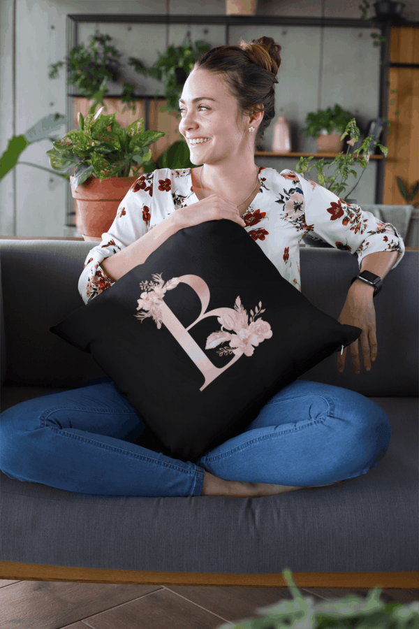 Custom Printed Monogram Letter B on Black Pillow Case mockup of a smiling woman holding a pillow