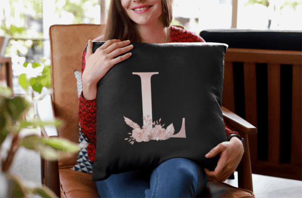 Custom Printed Monogram Letter J on Black Pillow Case mockup of a smiling woman holding a pillow