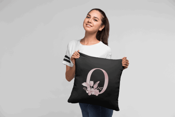 Custom Printed Monogram Letter O on Black Pillow Case mockup of a woman holding a pillow