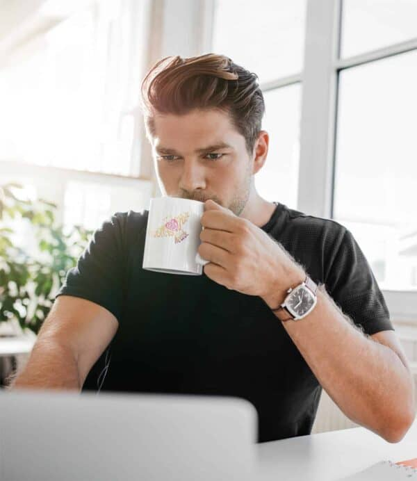Follow Your Heart Coffee Mug Design White 11oz coffee mug mockup featuring a man working from home