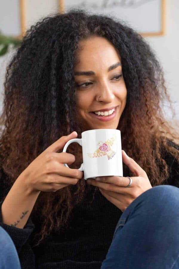 Follow Your Heart Coffee Mug Design White mockup of a curly haired woman with an 11oz mug in her hands