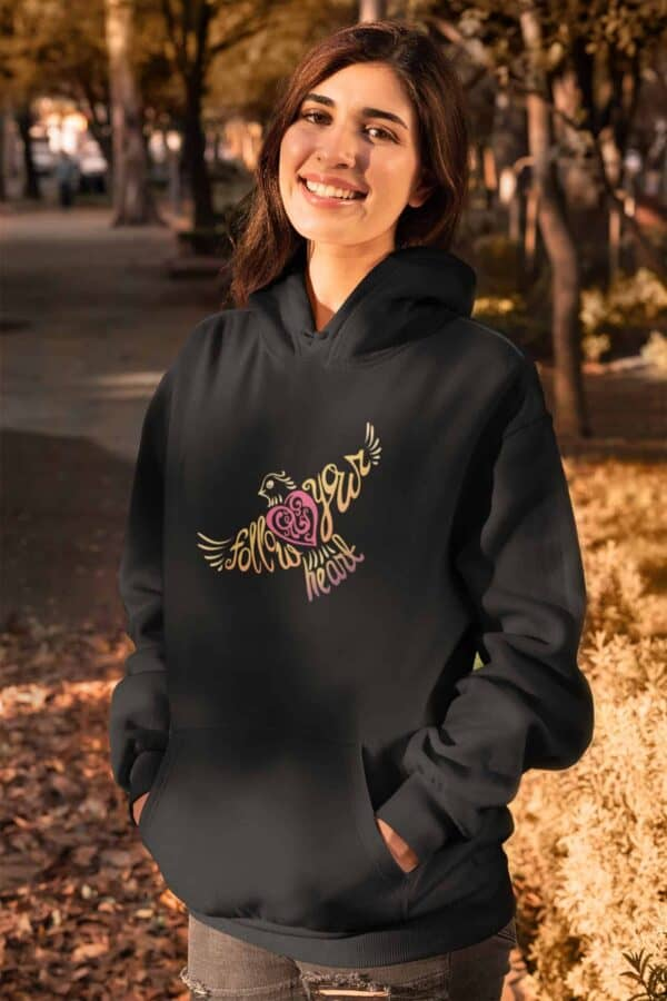 Follow Your Heart Hoodie Design Black mockup of a woman wearing a pullover hoodie in fall
