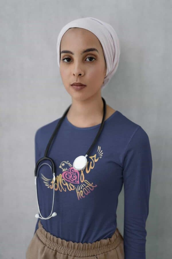 Follow Your Heart Long Sleeve T-Shirt Inspirational Design mockup of a doctor with a stethoscope