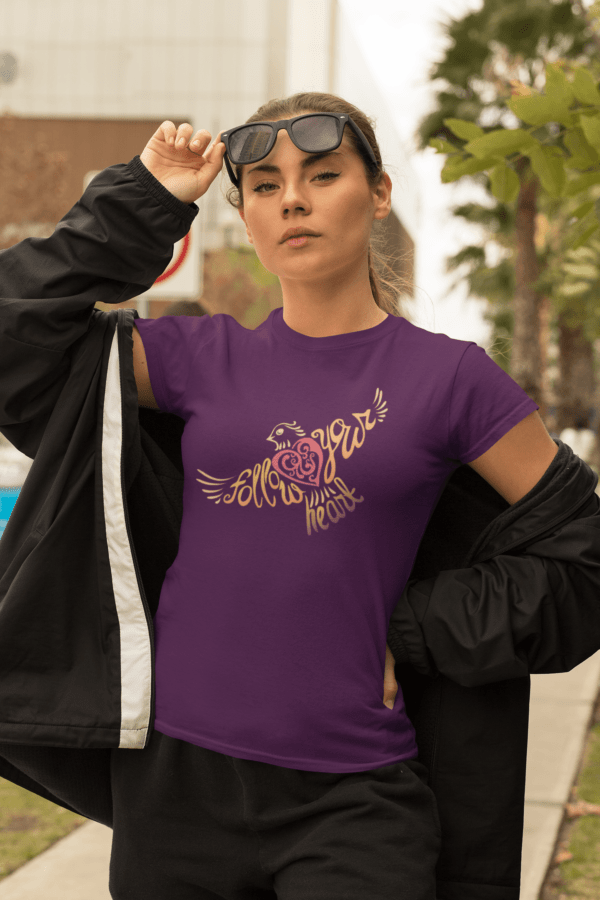 Follow Your Heart T-Shirt Design mockup of a bold woman wearing t-shirt and an athleisure outfit