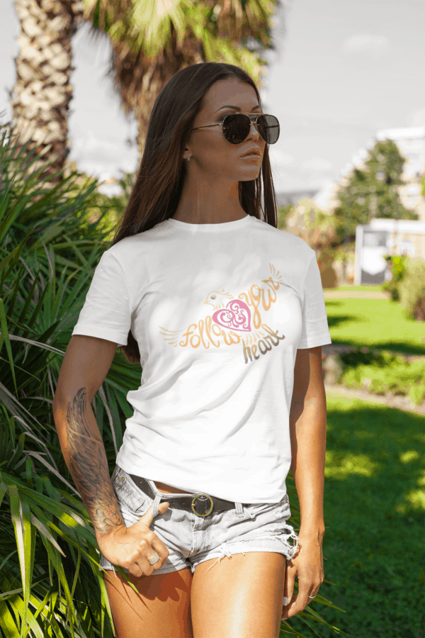 Follow Your Heart T-Shirt Design mockup of a stylish tattooed woman at a park