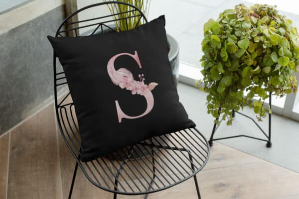 Custom Printed Monogram Letter S on Black Pillow Case mockup of a pillow on a chair