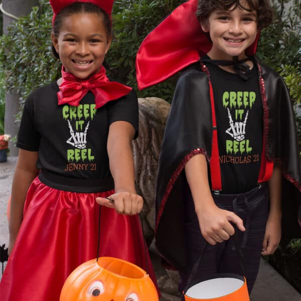 Boy and girl going trick or treating wearing Creep It Real T-Shirt