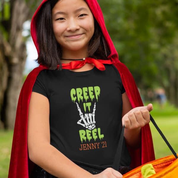 Girl wearing Creep It Real T-Shirt